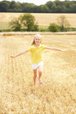 Girl Running Through Summer Harvested Field Stock Images