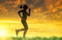Girl running at sunset Royalty Free Stock Photo