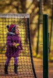 Girl running on the tennis court Royalty Free Stock Photos