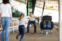 Girl running to father airport Royalty Free Stock Image