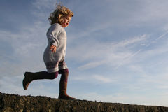 Girl running about to jump Stock Photo