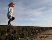 Girl running about to jump Royalty Free Stock Images