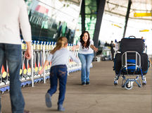 Girl running to mother airport Stock Images