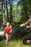 Girl running to mothers arms Royalty Free Stock Image