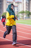 Girl running on track Royalty Free Stock Image