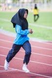 Girl running on track Stock Images