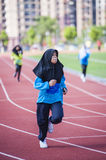 Girl running on track Royalty Free Stock Images