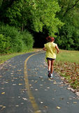 Girl running on trail Stock Photography