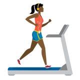 Girl running on treadmill. Stock Images