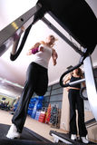 Girl running on the treadmill in the gym Stock Photo