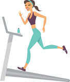 Girl running on the treadmill Stock Photos
