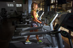 Girl Running on treadmill in the gym Stock Photo