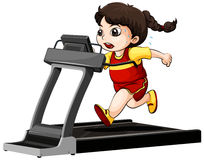 Girl running on treadmill Royalty Free Stock Images