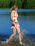 Girl running on water Royalty Free Stock Photography