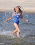 Girl running on waves Royalty Free Stock Images