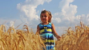 Girl running through a wheat field Royalty Free Stock Photography