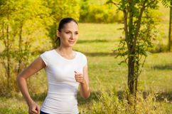 Girl running in white t-shirt Royalty Free Stock Photos