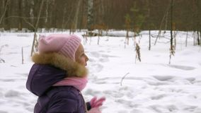 Girl running on winter forest during family walking. Winter vacation in forest. Girl running on winter forest during family walking. Family walking in snowy stock video footage