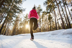 The girl running in winter Park. By evening Royalty Free Stock Photo