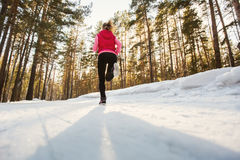 The girl running in winter Park Stock Photography