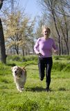 Girl running with your dog Stock Photo