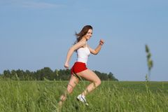 The girl runs. On road in the afternoon Royalty Free Stock Photography