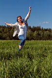 Girl runs across the green grass Royalty Free Stock Photo