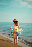 Girl runs along the beach Royalty Free Stock Photo