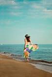 Girl runs along the beach Stock Image