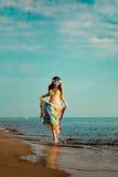 Girl runs along the beach Royalty Free Stock Photos