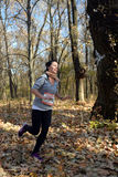 Girl runs along the forest leaves Royalty Free Stock Photo
