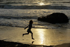 Girl runs along the shore. Of the Mediterranean Sea in Israel Royalty Free Stock Images