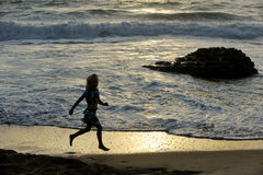 Girl runs along the shore. Of the Mediterranean Sea in Israel Stock Photos