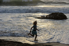 Girl runs along the shore. Of the Mediterranean Sea in Israel Royalty Free Stock Image