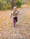 Girl runs in autumn Royalty Free Stock Photos
