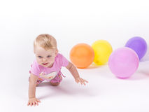 Girl runs away from colorful balloons. Girl escapes by crawling colorful balloons Stock Images
