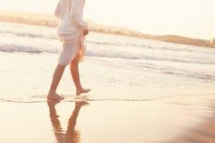The Girl Runs Barefoot along the Sandy Beach of the Sea Stock Image