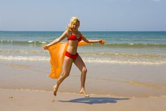 Girl runs on beach Royalty Free Stock Photo