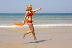 Girl runs on beach Royalty Free Stock Image
