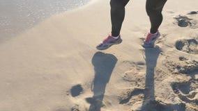 The girl runs on the beach stock video