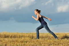 Girl runs in the evening Stock Image