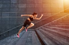 Girl runs fast on a modern stair stock photography