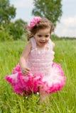Girl runs on a glade Stock Photos