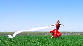 Girl runs on green field Stock Photo