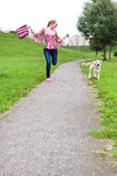 Girl runs with her puppy. Girl runs on the track with her puppy Royalty Free Stock Image