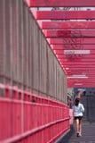 Girl runs over the Williamsburg bridge. Brooklyn, New York, USA stock image