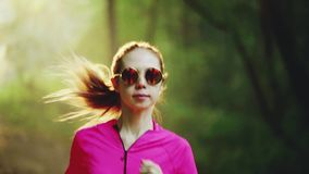 Girl runs through park. Girl runs through the park in morning stock video footage