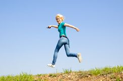 Girl runs on the road Royalty Free Stock Photos