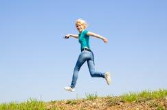 Girl runs on the road Royalty Free Stock Photos