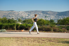 Girl run on the road Royalty Free Stock Photos